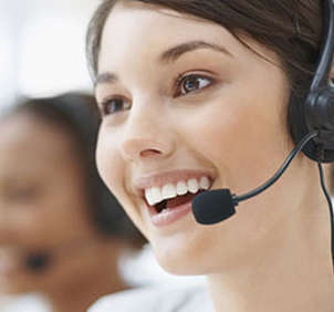 Smiling female telemarketer on call