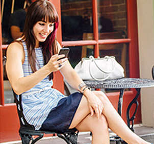 Woman sitting outside on cellphone
